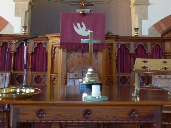 The communion table with the pulpit